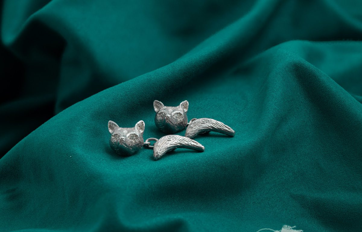 Bespoke silver fox head and tail cufflinks